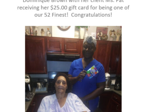 Dominique Brown Receives Her Gift Card